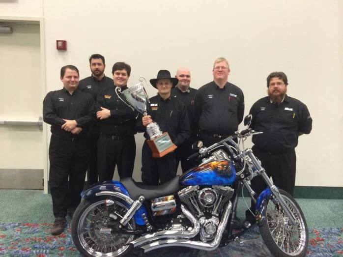 judge staff with trophy and motorcycle