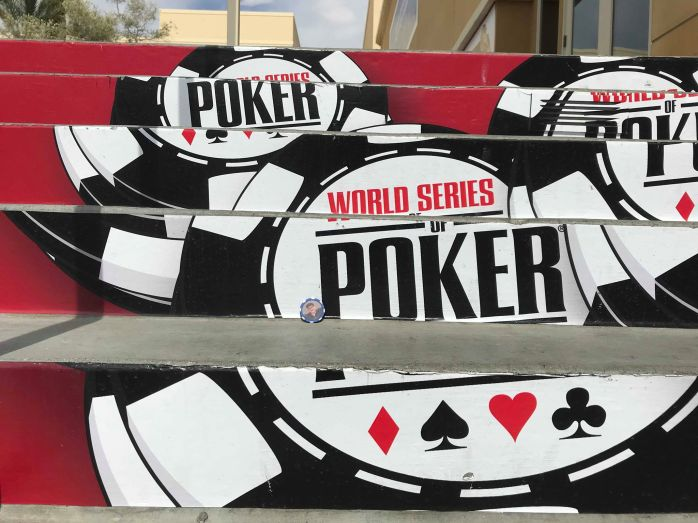 HBMO poker chip on steps of World Series of Poker